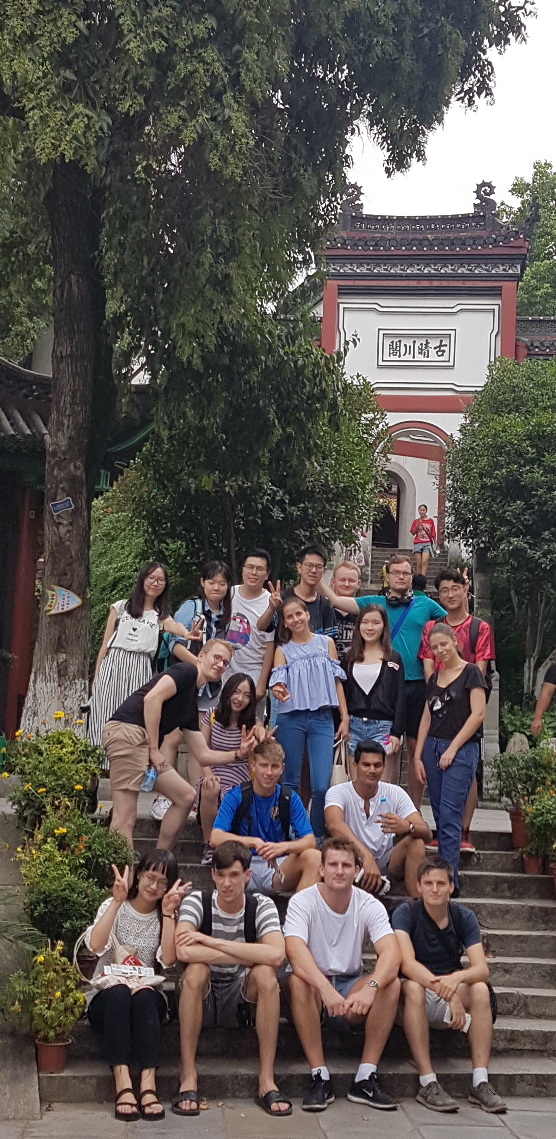 Students outside Chinese temple