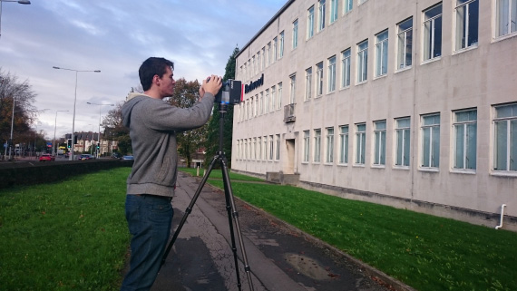 Student scanning building.